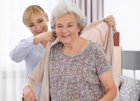 caregiver caring for elder woman
