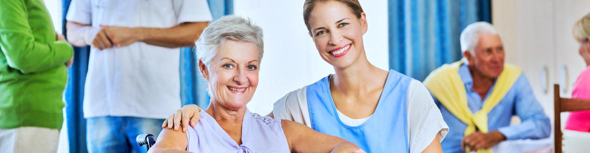 caregiver and elder woman smiling