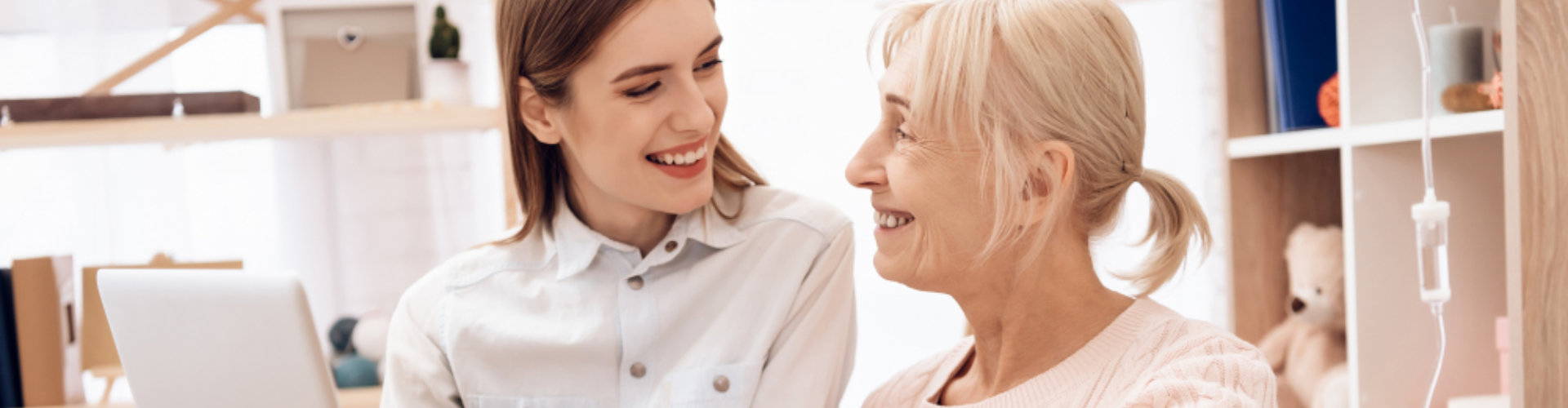 nurse and elderly smiling at each other